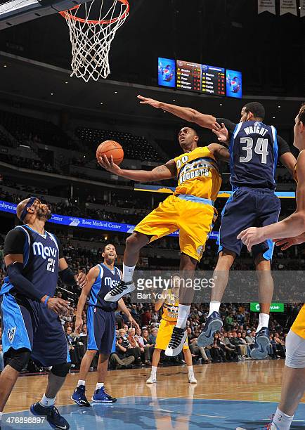 Darrell Arthur of the Denver Nuggets drives to the basket against the Dallas Mavericks on March 5 2014 at the Pepsi Center in Denver Colorado NOTE TO...