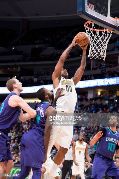 Darrell Arthur of the Denver Nuggets drives to the basket for a slam dunk against the Charlotte Hornets at the Pepsi Center on February 5 2018 in...