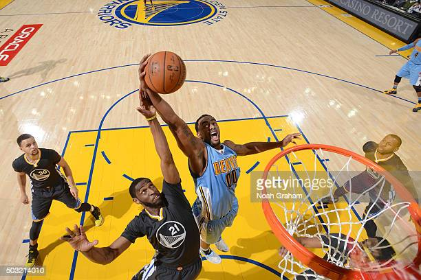 Darrell Arthur of the Denver Nuggets goes for the dunk during the game against the Golden State Warriors on January 2 2016 at ORACLE Arena in Oakland...