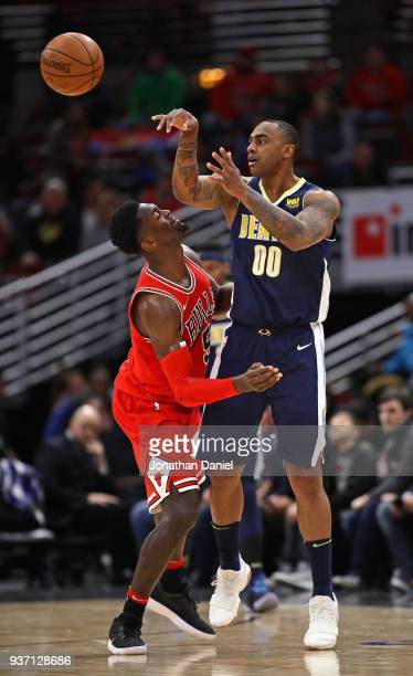 Darrell Arthur of the Denver Nuggets passes over Bobby Portis of the Chicago Bulls at the United Center on March 21 2018 in Chicago Illinois The...
