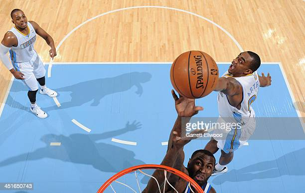 Darrell Arthur of the Denver Nuggets reaches for a rebound against DeJuan Blair of the Dallas Mavericks on November 23 2013 at the Pepsi Center in...