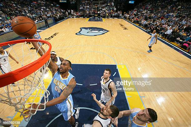 Darrell Arthur of the Denver Nuggets shoots against the Memphis Grizzlies on March 16 2015 at FedExForum in Memphis Tennessee NOTE TO USER User...