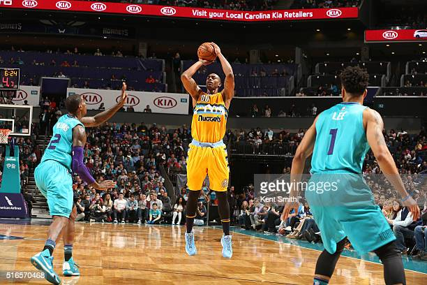 Darrell Arthur of the Denver Nuggets shoots the ball against the Charlotte Hornets on March 19 2016 at Time Warner Cable Arena in Charlotte North...