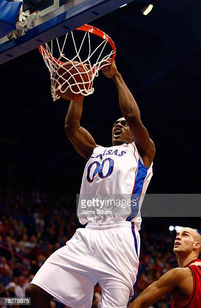Darrell Arthur of the Kansas Jayhawks dunks during the game against the Eastern Washington Eagles on December 5, 2007 at Allen Fieldhouse in...