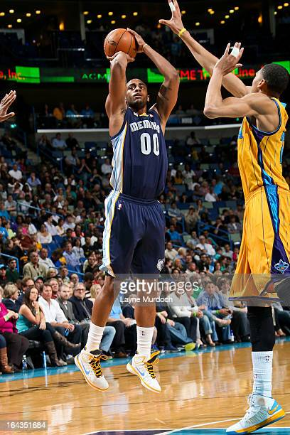 Darrell Arthur of the Memphis Grizzlies shoots against Anthony Davis of the New Orleans Hornets on March 22 2013 at the New Orleans Arena in New...