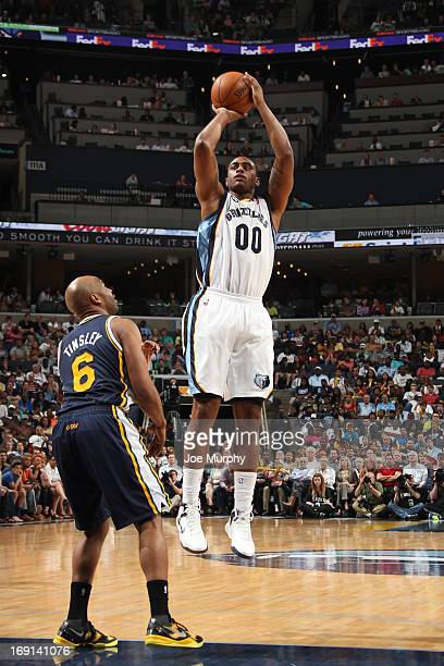 Darrell Arthur of the Memphis Grizzlies shoots against Jamaal Tinsley of the Utah Jazz on April 17 2013 at FedExForum in Memphis Tennessee NOTE TO...