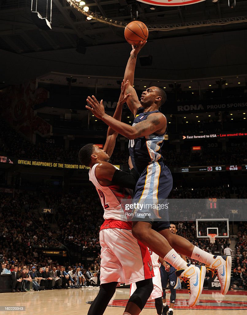 Darrell Arthur #00 of the Memphis Grizzlies shoots against Rudy Gay #22 of the Toronto Raptors on February 20, 2013 at the Air Canada Centre in Toronto, Ontario, Canada.
