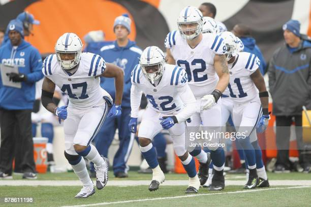 Darrell Daniels, Kenny Moore II and Margus Hunt of the Indianapolis Colts line up for the kickoff during their game against the Cincinnati Bengals at...