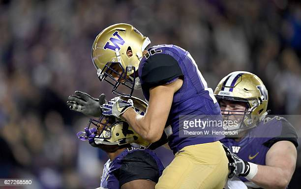 Darrell Daniels of the Washington Huskies celebrates with Aaron Fuller after Daniels scored a touchdown against the Colorado Buffaloes during the...
