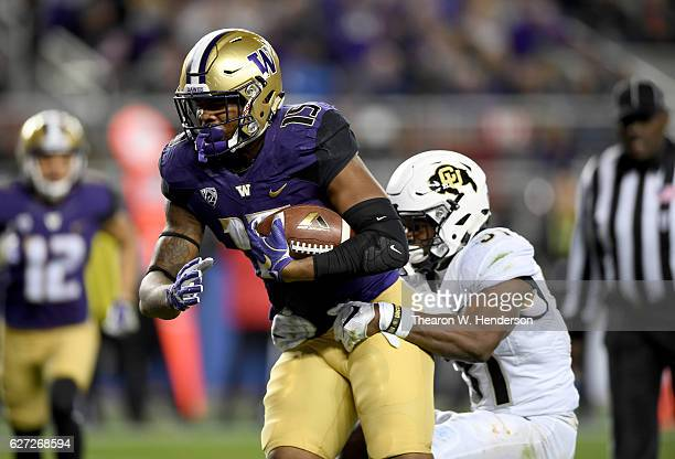 Darrell Daniels of the Washington Huskies goes in for a touchdown while covered by Kenneth Olugbode of the Colorado Buffaloes during the Pac12...