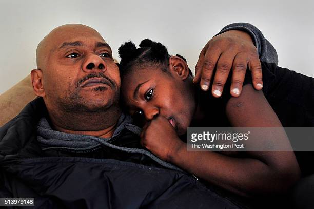 Darrell Gilmore with his daughter Diamond Nixon age 10 Police one morning in January raided Darrell Gilmores house in Southeast DC looking for...