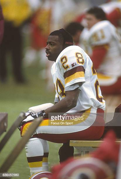 f105ef48f Darrell Green of the Washington Redskins looks on from the bench against  the Phoenix Cardinals during