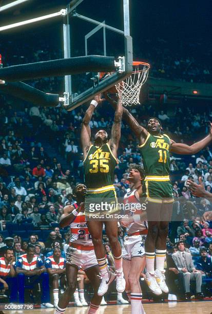 Darrell Griffith of the Utah Jazz battles for a rebound with teammate James Hardy against the Washington Bullets during an NBA basketball game circa...
