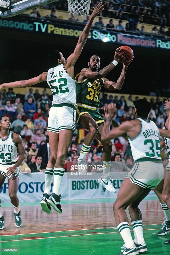 Darrell Griffith #35 of the Utah Jazz goes up for a shot against Darren Tillis #52 of the Boston Celtics during a game played in 1983 at the Boston Garden in Boston, Massachusetts.