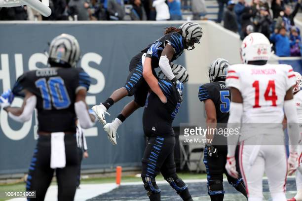 Darrell Henderson celebrates a touchdown with Drew Kyser of the Memphis Tigers against the Houston Cougars during the 2nd half on November 23, 2018...