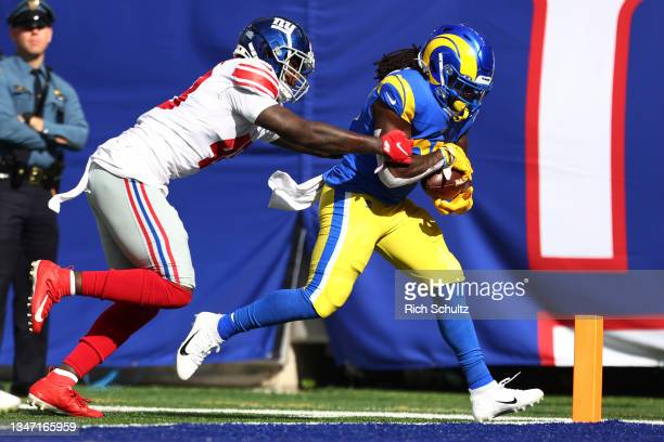 Darrell Henderson of the Los Angeles Rams catches a pass for a touchdown as Tae Crowder of the New York Giants defends in the second quarter of a...