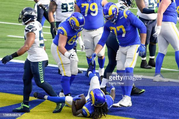 Darrell Henderson of the Los Angeles Rams celebrates with Austin Corbett and Andrew Whitworth 77 after scoring a touchdown against the Seattle...