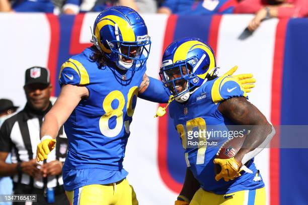 Darrell Henderson of the Los Angeles Rams is congratulated by Tyler Higbee after scoring a touchdown against the New York Giants in the second...