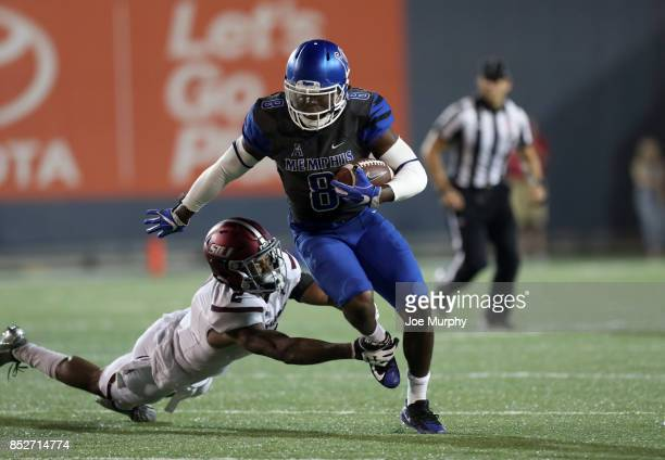 Darrell Henderson of the Memphis Tigers breaks a tackle against Jeremy Chinn of the Southern Illinois Salukis on September 23, 2017 at Liberty Bowl...