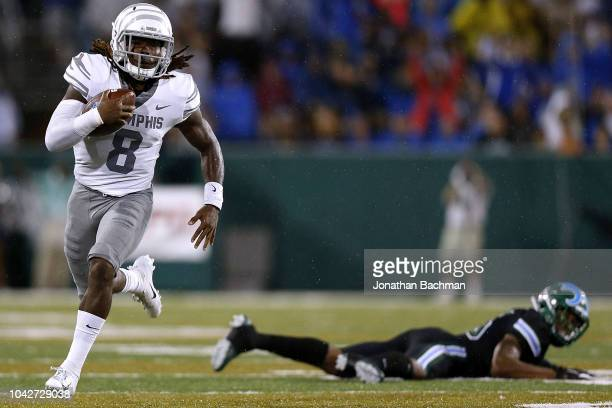 Darrell Henderson of the Memphis Tigers runs with the ball for a touchdown as Thakarius Keyes of the Tulane Green Wave defends during the first half...