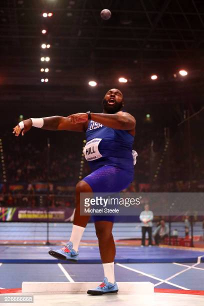 Darrell Hill of United States competes in the Shot Put Mens Final during the IAAF World Indoor Championships on Day Three at Arena Birmingham on...