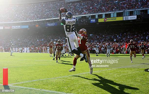 Darrell Jackson of the Seattle Seahawks makes a reception against Joselio Hanson of the San Francisco 49ers at Monster Park on November 7, 2004 in...