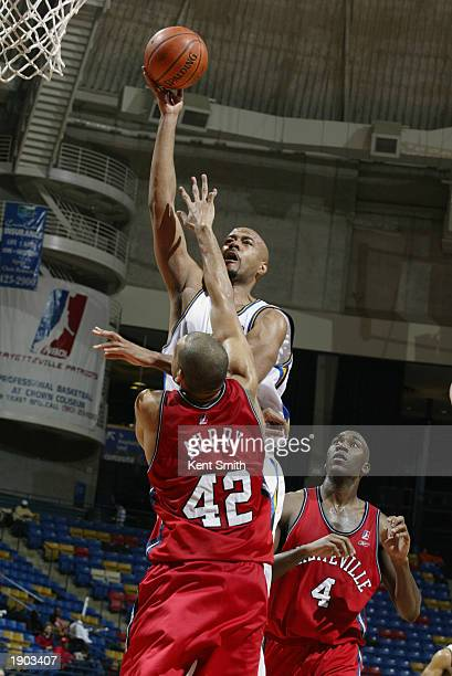 Darrell Johns of the Roanoke Dazzle hooks a shot over Jeff Aubry of the Fayetteville Patriots during Game One of the NBDL Semifinals at the Crown...