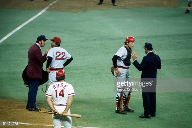 Darrell Johnson and catcher Carlton Fisk of the Boston Red Sox converse with the Umpires during the World Series against the Cincinnati Reds at...