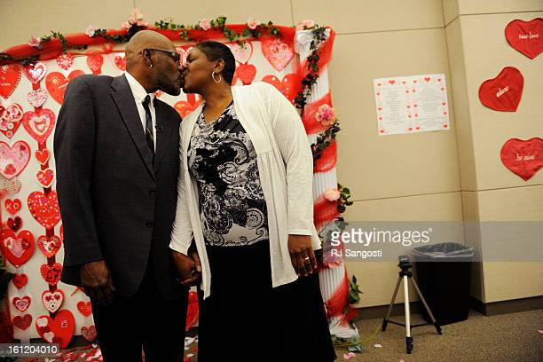 Darrell Johnson left kisses his new wife Margaret Tuesday Feb 14 after getting married in the Denver Clerk and Recorder's conference room that was...
