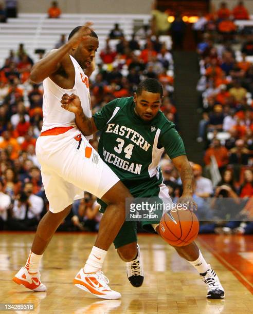 Darrell Lampley of the Eastern Michigan Eagles drives around Scoop Jardine of the Syracuse Orange during the game at the Carrier Dome on November 29,...