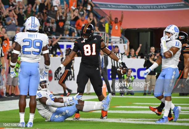 Darrell Langham of the Miami Hurricanes scores a touchdown in the second quarter against the North Carolina Tar Heels at Hard Rock Stadium on...