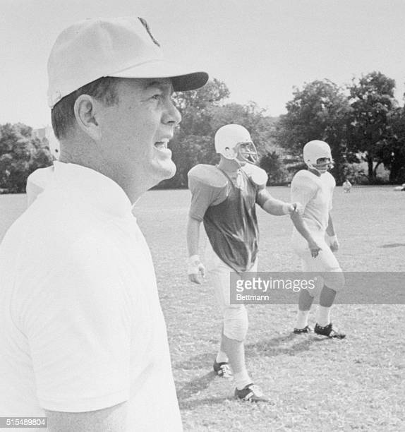 Darrell Royal, coach of the defending National Championship University of Texas Longhorn football team, urges them on during the early part of their...