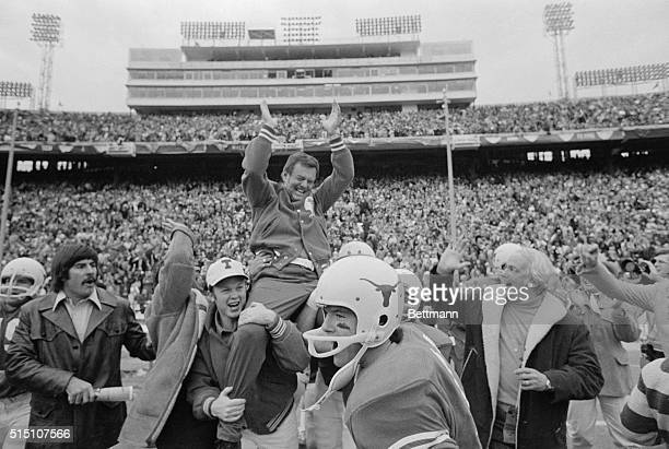 Darrell Royal, head coach of the University of Texas is carried off the field by his players following Texas' victory over Alabama in the Cotton Bowl...