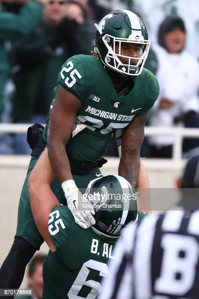 Darrell Stewart Jr #25 of the Michigan State Spartans celebrates a first half touchdown with Brian Allen while playing the Penn State Nittany Lions...