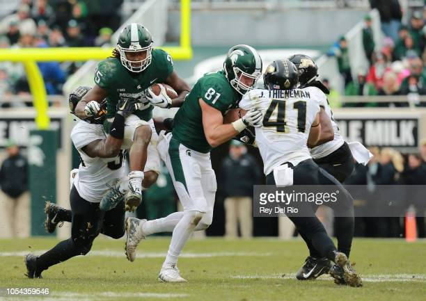 Darrell Stewart Jr #25 of the Michigan State Spartans runs the ball after a catch and tackled by Jaylan Alexander of the Purdue Boilermakers in the...