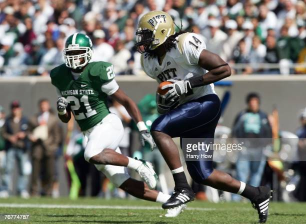Darrell Strong of the Pittsburgh Panthers makes a catch in front of Otis Wiley of the Michigan State Spartans during the second quarter at Spartan...