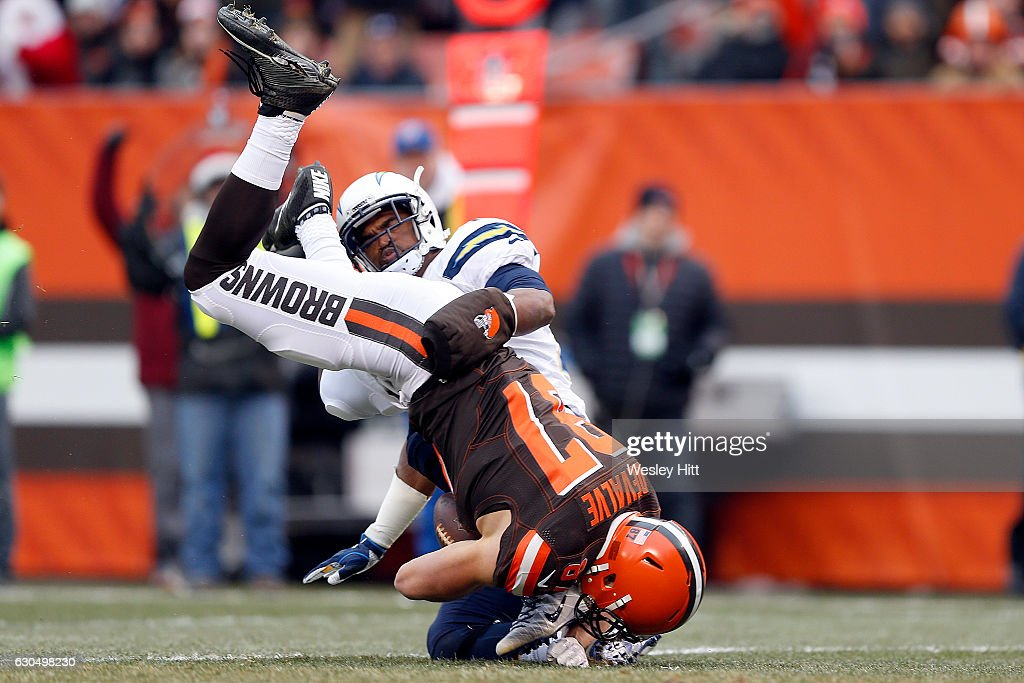 Darrell Stuckey #25 of the San Diego Chargers tackles Seth DeValve #87 of the Cleveland Browns at FirstEnergy Stadium on December 24, 2016 in Cleveland, Ohio.
