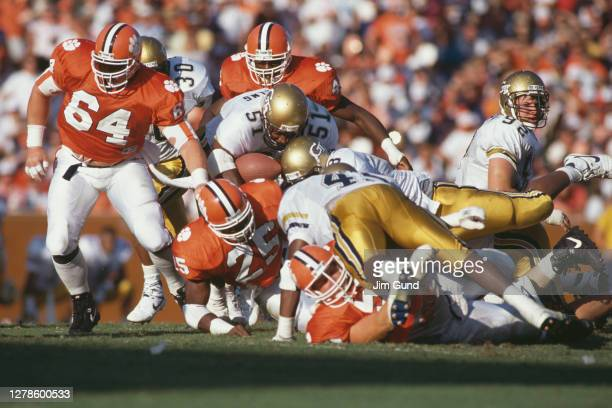 Darrell Swilling, Outside Linebacker carries the ball into the tackle for the Georgia Tech Yellow Jackets during the NCAA Atlantic Coast Conference...