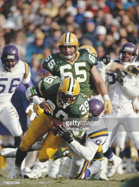 Darrell Thompson Running Back for the Green Bay Packers is tackled by Minnesota Vikings Defensive End Thomas Strauthers during their National...