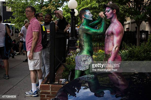 Darrell Thorne of New York City, helps friend Steve Schepis also of New York City, put on their final makeup touches before performing in the Capital...