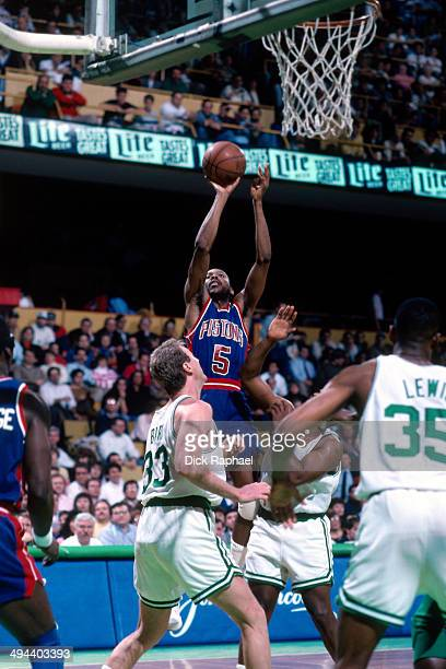 Darrell Walker of the Detroit Pistons takes a shot against Larry Bird of the Boston Celtics during a game played in 1992 at the Boston Garden in...