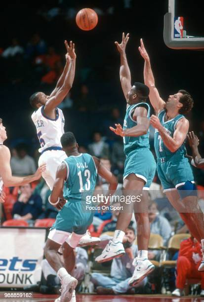 Darrell Walker of the Washington Bullets shoots against the Charlotte Hornets during an NBA basketball game circa 1991 at the Capital Centre in...