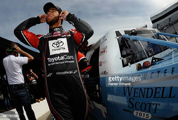 Darrell Wallace, Jr., driver of the 2015 NASCAR Hall of Fame Inductee Wendell Scott Toyota, gets ready before practice for the NASCAR Camping World...