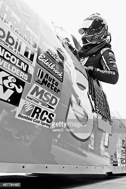 Darrell Wallace, Jr., driver of the 2015 NASCAR Hall of Fame Inductee Wendell Scott Toyota, climbs into his truck during practice for the NASCAR...