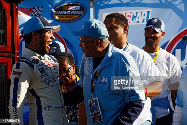 Darrell Wallace, Jr., driver of the 2015 NASCAR Hall of Fame Inductee Wendell Scott Toyota, celebrates with Wendell Scott, Jr. In Victory Lane after...