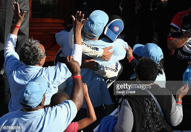 Darrell Wallace, Jr., driver of the 2015 NASCAR Hall of Fame Inductee Wendell Scott Toyota, embraces Wendell Scott, Jr. In Victory Lane after Wallce...