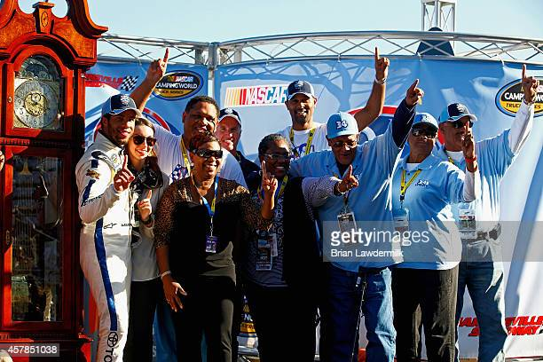 Darrell Wallace, Jr., driver of the 2015 NASCAR Hall of Fame Inductee Wendell Scott Toyota, far left, poses with girlfriend Shelby Willis and the...
