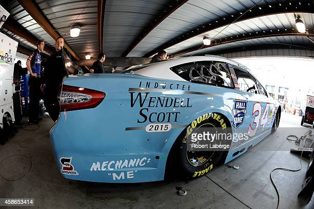 Darrell Wallace, Jr., driver of the 2015 NASCAR Hall of Fame Inductee Wendell Scott Toyota sits in his car during practice for the NASCAR Camping...