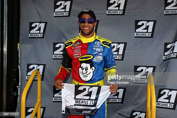 Darrell Wallace Jr driver of the Camping World Toyota celebrates with the pole award after qualifying for pole position for the NASCAR Camping World...