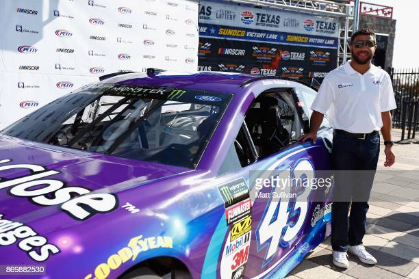 Darrell Wallace Jr driver of the Click n' Close Ford poses with his newlyunveiled car at Texas Motor Speedway on November 3 2017 in Fort Worth Texas